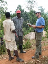 CHANS-Net member Joel Hartter conducts an interview through his field assistant and interpreter Peace Mwesigwe with a local resident from the Bakiga tribe in a village near Kibale National Park.