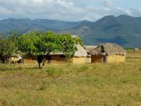 Amerindian houses in the Rupununi Region. The Rupununi Mountain Range is visible in the background.
