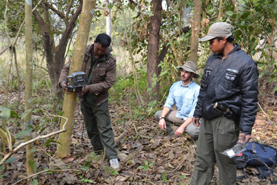 Neil Carter setting tiger camera trap in Chitwan National Park